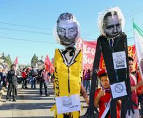 Argentine unions flex muscle in anti-governmen... File photo: Effigies of Argentine President Mauricio Macri and US President ...