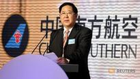 China to prosecute former top executives for alleged graft