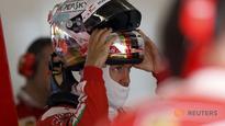 Slick Vettel quickest in damp final China practice