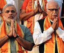 BJP's peace-keeping mission: Modi meets Advani