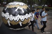 64 sculptures in shape of soccer ball exhibited