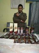 Two held with 61 pouches of liquor