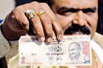 Rupee carry appeal boosted by India rate surprise before Fed