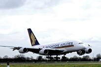 Low fuel prices boost Singapore Airlines Group profits