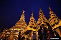 People visit Shwedagon pagoda in Yangon, Myanmar