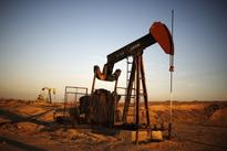 Oil prices rise as OPEC's output cuts drain stocks