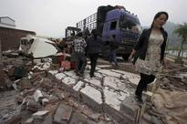 Portable ATMs, phone-charging in China quake zone