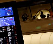 Asian stocks slip, Fed's decision day makes investors wary
