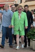 Trendsetter Elton John comes up short in lime green suit as he holidays in Sardinia