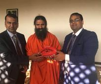Taking AFL Footy to Indian billionaires, and spiritual gurus