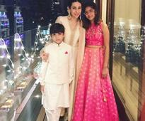 Karisma Kapoor strikes a picture perfect pose with kids Samaira and Kiaan