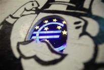 ECB cuts interest rates, open to further action