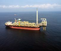 Oil slips as U.S. stock build raises glut worr... The oil ship Prof John Evans Atta Mills is seen moored off the coast of the ...