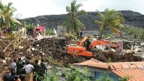 Sri Lanka: 19 killed as mountain of garbage collapses after fire