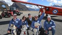 Antarctic Heritage Trust tractors cross the finish line for Sir Ed's hut