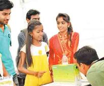 Aarti of Anna nagar slum greets in English before explaining her model