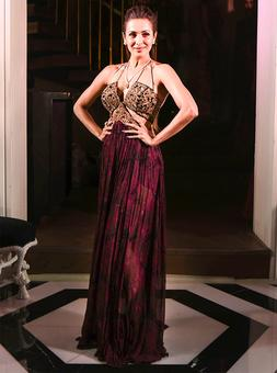 Seriously stunning! Malaika in a red spaghetti-strap gown