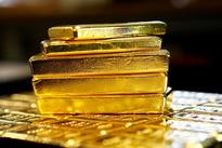 Gold inches up as dollar, Asian stocks slip