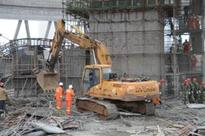 China says families of 74 workers killed in construction collapse to receive pa...