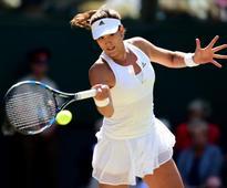 Garbine Muguruza and Agnieszka Radwanska reach second round at Roland Garros