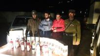 Two held for smuggling liquor