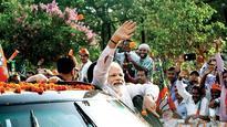 Narendra Modi holds roadshow in Navin Patnaik's turf