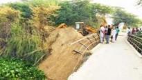 Shaken villagers start bridge repair, Army halts them