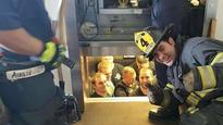 Who you gonna call: Firefighters rescue police stuck in elevator