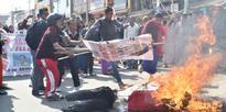 Sitinprotest and rally stage against fake encounter, effigies of Ibobi, Joykumar and Jhalajit burnt