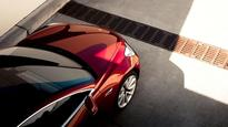 Tesla surges as Wall Street bets on Model 3