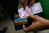 Rupee swings up, bonds trim losses on market talk of S&P ratings upgrade