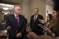 McAuliffe lawyer: Investigators have nothing on him