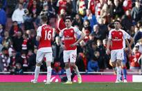 Late goals earn Leicester draw, cost Arsenal victory
