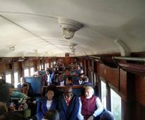 PM Modi travels in General Class train, pays tribute to Gandhiji
