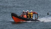 Woman drowned after being hit by rogue wave