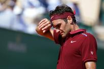 Back injury forces Federer to pull out of Madrid