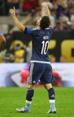 Record-breaker Messi waves his magic wand; fir... Lionel Messi #10 of Argentina dribbles the ball against Michael Br...