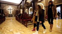 For Iraq's Christians, a bittersweet first Christmas home after ISIS