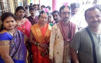 BMC polls: Newly-married couple queues up to cast their votes