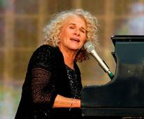 Music legend Carole King plays Tapestry in its entirety for first time ever onstage - and Elton John and Tom Hanks pay tribute
