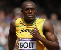 Bolt wins 100m in photo finish
