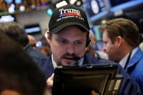 Wall Street flat as tech gains offset weakness in banks