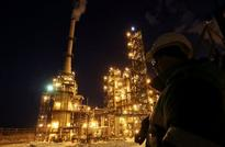 Oil pares gains after one week-high as Russia-Saudi sign pact
