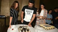 Arjun Kapoor cuts his pre-birthday cake with 'Mubarakan' co-stars Ileana D'Cruz and Athiya Shetty