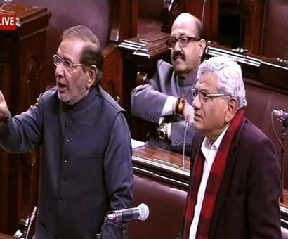 In Parl, Cong, Left, JDU want PM to apologise for raincoat remark