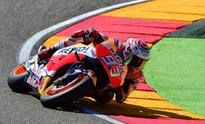 Marquez shrugs off crash to claim Aragon pole