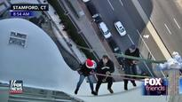That Holiday Tradition When Rick Reichmuth Rappells Down a 22-Story Building