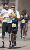 Army veteran finishes what he started — on prosthetic legs