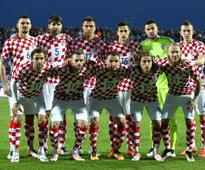 Soccer-Croatia relying on dynamic midfield duo in tough group