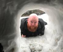 Forget snowmen, this guy was on a mission to build an igloo